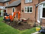 Our Micro-Digger was able to fit between the house and garage no problen to start the work.