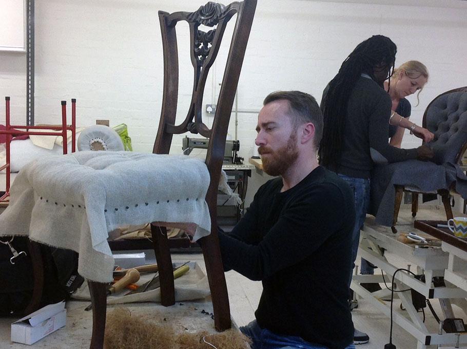 Upholstery student finishing ntouches